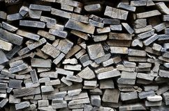 Detailed view to stacked firewood. Detailed view to stacked and seasoned firewood for an open-hearth fireplace Stock Image