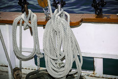 Detailed view of various ropes hanging on the side of tall ship port wall Stock Photography