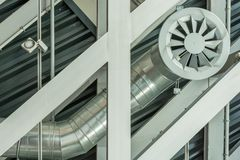 Ceiling construction made of steel with the pipe of the ventilation system stock photography