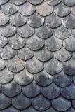 Detailed view of wall texture lined with slate-shaped fish scales, from a ruined building. Typical and traditional schist stone material, used as external royalty free stock image