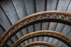 Arrott Building - Half Circular Spiral Marble Staircase - Downtown Pittsburgh, Pennsylvania. A detailed view of wood banisters and cast iron spindles on a half Royalty Free Stock Photos