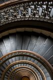 Arrott Building - Half Circular Spiral Marble Staircase - Downtown Pittsburgh, Pennsylvania. A detailed view of wood banisters and cast iron spindles on a half royalty free stock photography