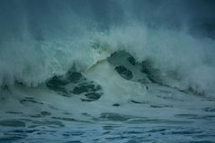 Detailed winter storm wave breaking and splashing on shore Royalty Free Stock Image