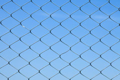Detailed wire fence against blue sky Royalty Free Stock Images