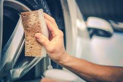 Detailing Car Alloy Wheels. Using Brush. Car Washing Theme royalty free stock photography