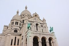 Detaill of the Basilica of the Sacred Heart of Paris on an overcast day. Detail of the front facade of the Basilica of the Sacred Heart or `Sacre Coeur` of Paris Stock Photo