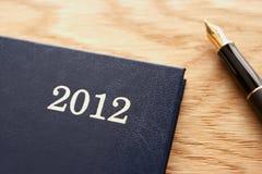 Detailleer agenda en pen Stock Foto's