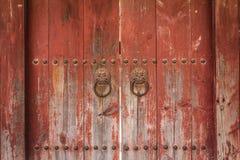 Details of an ancient asian wooden door Stock Image