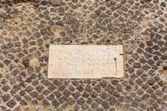 Plaque in Cobblestones in Pompeii stock photos