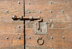Details of an ancient Italian door. Royalty Free Stock Image