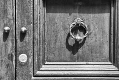 Details of an ancient Italian door in Florence, Italy (Black and White) Royalty Free Stock Photo