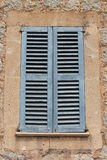 Rustic Mediterranean architecture with blue shutters, Majorca, Spain royalty free stock photography