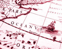 Details on antique sailing chart. A monochrome photograph of an old sailing ship details on an antique sailing navigation chart of Africa at the equator Royalty Free Stock Photo