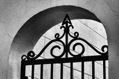 Details of an arc with a gate with arrow Royalty Free Stock Photo