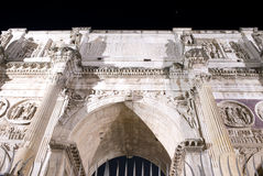 Details arch of Constantine. The Arch of Constantine is a triumphal arch in Rome, situated between the Colosseum and the Palatine Hill Stock Photo