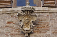 Details of architecture historical buildings. Italy. stone mask. Stock Image