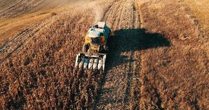 Details of autumn harvest. Aerial view of combine harvesting over the hills stock video