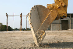 Details of backhoe on digger. Details of backhoe on industrial digger, construction site scene Royalty Free Stock Photo