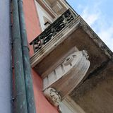 Details of a Balcony of an Old Medieval Style Building from Below stock photography