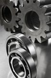 Details of ball-bearings. Ball-bearings in front of cog-wheels Stock Photos