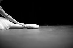 Details of ballet dancer sitting on floor Royalty Free Stock Photos