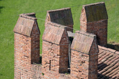 Details of the battlements of a medieval castle. Royalty Free Stock Photo