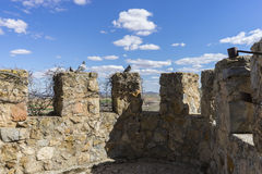 Details of battlements of a medieval castle. Town of Consuegra i Royalty Free Stock Photos