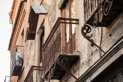 Details of the beautiful streets and facades of the city of Toledo, Spain. Beautiful streets of the city of Toledo, with balconies and sunny day royalty free stock photo