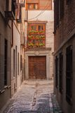Details of the beautiful streets and facades of the city of Toledo, Spain. Beautiful streets of the city of Toledo, with balconies and sunny day stock images