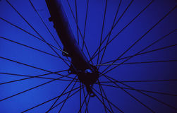 Details of a Bicycle Wheel. Closeup view of bicycle wheel, dark background and strong highlights Royalty Free Stock Image