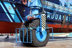 Details of big tires on shipyard travelift carrying a boat. Great tires used in a shipyard of Alicante city for carry a coastguard for made reparations royalty free stock photo