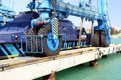 Details of big tires on shipyard travelift carrying a boat. Great tires used in a shipyard of Alicante city for carry a coastguard for made reparations stock photography