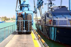Details of big tires on shipyard travelift carrying a boat. Great tires used in a shipyard of Alicante city for carry a coastguard for made reparations stock image