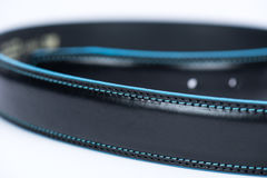 Details on black classic belt with blue line Royalty Free Stock Photography