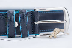 Details on black classic belt with blue line Stock Images