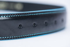 Details on black classic belt with blue line Royalty Free Stock Photos