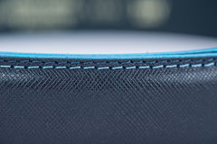 Details on black classic belt with blue line Stock Photo