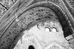 Details in black and white at La Alhambra de Granada. Architectural details of the ceiling and archway at La Alhambra. Ornate molding and detail work of with Royalty Free Stock Images