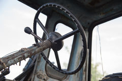 Details of a blue village tractor with dirty wheels, engine, rud Stock Image
