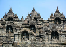 The temple of Borobudur on Java in Indonesia. Details of Borobudur Temple on Java, Indonesia. Built in the 9th century, the temple was designed in Javanese Royalty Free Stock Photo