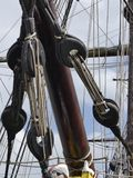 Details of bowsprit and pulleys on board vintage sailing ship. Stock Images