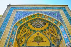Details of brick portal of Malek museum, Tehran, Iran. The brick muqarnas arch with intricate tile patterns decorates the portal of Malek museum, Bagh-e Melli royalty free stock image