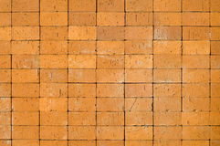 Details of brick wall. An abstract background created by closeup details blocks making up a yellowish brick wall Royalty Free Stock Photo