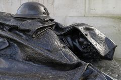 The Royal Artillery war memorial in Hyde ParkLondon. Details of the bronze statue of a fallen soldier, part of the Royal artillery memorial Royalty Free Stock Photography