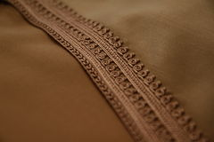Details of a brown Moroccan djellaba Stock Photos