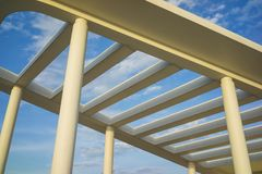 Details of building roof with cement lines against blue sky Stock Photo