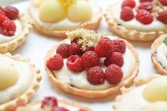 Details of cakes with elderberry cream Stock Photo
