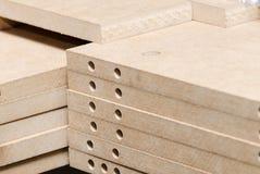 Details carpenter for furniture. MDF close-up Stock Photos