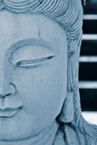 Details of carved Buddha face. Closeup of the carved face on a statue of Buddha Royalty Free Stock Photos