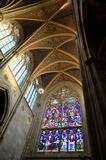 Details of the ceiling and a stained glass window in a ghotic cathedral in Vienna Stock Image